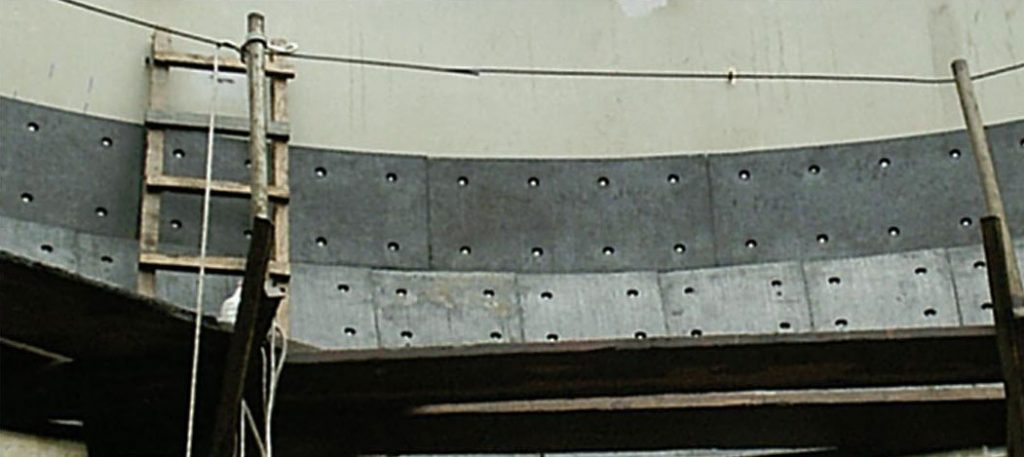 Coating hoppers and bunkers with rubber